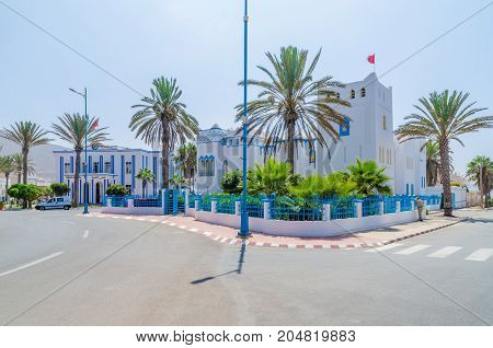 BEautiful blue and white washed buildings at roundabout in Sidi Ifni, Morocco, North Africa.
