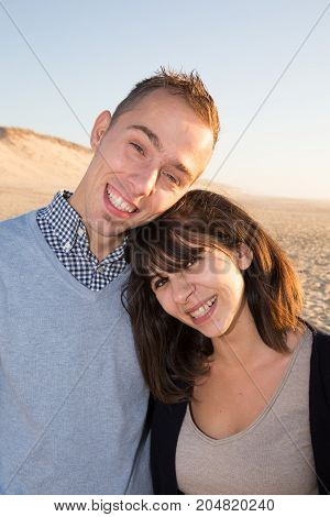 Happy Just Married Couple Walking On A Sandy Beach