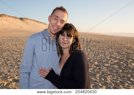 Lovers Couple In Love Having Fun Dating On Beach Portrait. Beautiful Healthy Young Adults Girlfriend