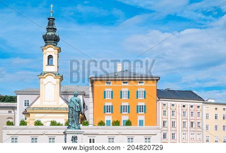 Austria Salzburg the palaces and bell tower of Mozart square with the Mozart monument in the foreground