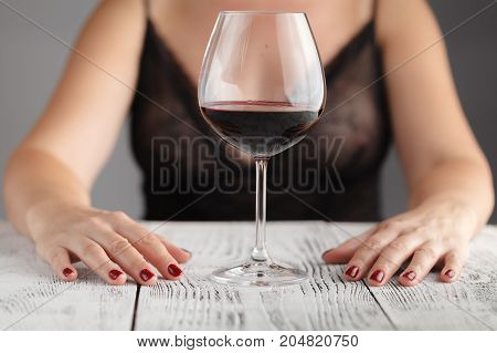 Young girl one with glass of wine