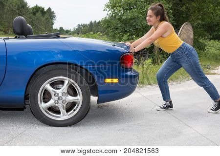 Pretty Girl Woman Pushing Car Out Of Gasoline