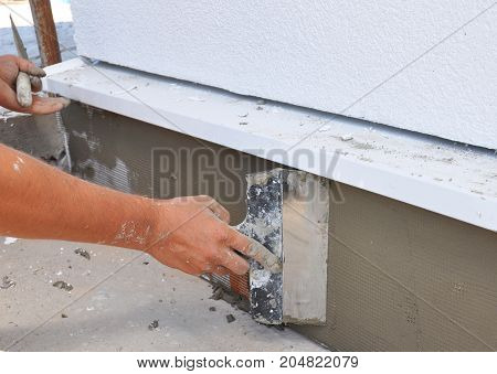 House foundation wall insulation with styrofoam sheets and plastering for Energy Saving Home.