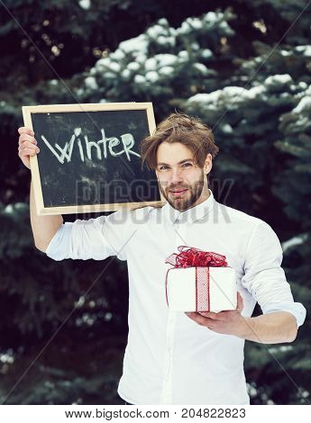 Handsome Man With Winter Blackboard And Present Box Outdoor