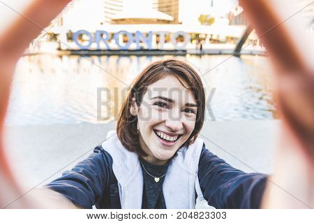Happy Smiling Girl Taking A Selfie In Toronto