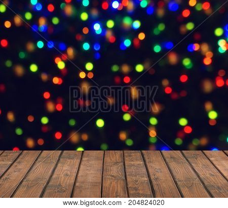 Empty wooden deck on blurred background with bokeh. Christmas background.