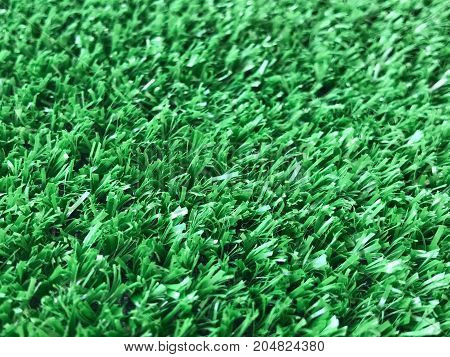 Artificial green turf background and texture selective focus