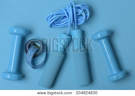 Health Regime And Fitness Symbols. Dumbbells And Skipping Rope