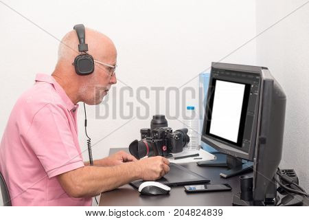 a man designer using graphics tablet for editing