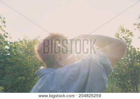 Portrait of woman looking away background of sunset with copy space.