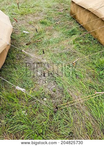 Several Rope Vintage Army Military Tents In A Field On Grass