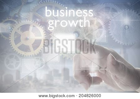 Finger clicking on a business growth touch screen