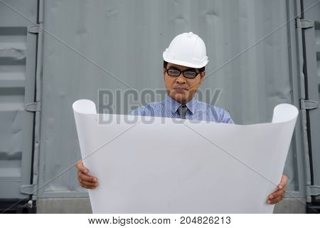 Engineer Manager Look At Consturction Paper Plan