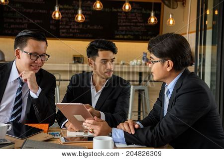 Businessman Team Discuss Project At Coffee Cafe