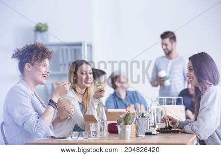 Workers Eating At The Office