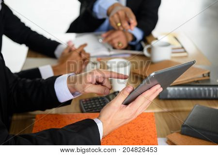 Businessman Team Discuss Project Using Tablet