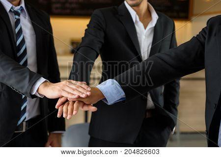Businessman Team Touching Hands, Teamwork