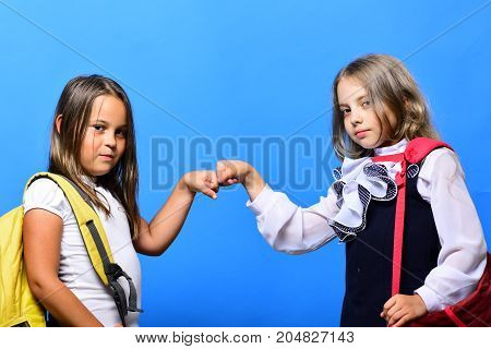 Kids Wearing Schoolbags Beat Each Others Fists