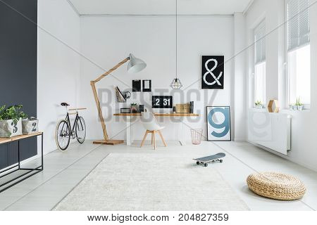 Workspace With Bike And Letter Posters