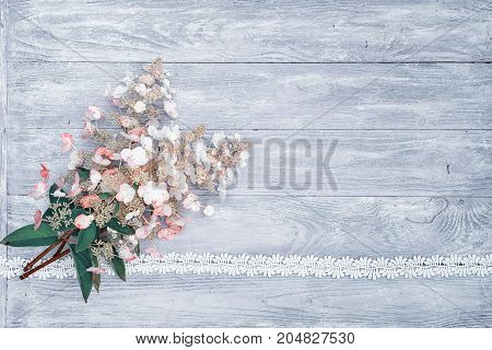bouquet of pink-white hydrangeas on a wooden table, tied with a lace ribbon and lace as a frame, top view with copy space for your text. suitable as a wedding or birthday invitation card background.