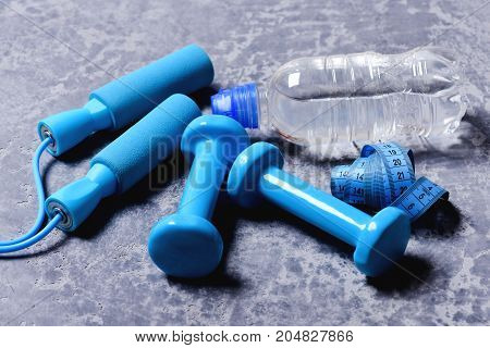 Sports And Health Idea. Dumbbells, Cyan Skipping Rope, Water Bottle