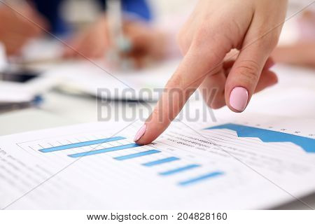 Female Arm Point Finger In Financial Graph