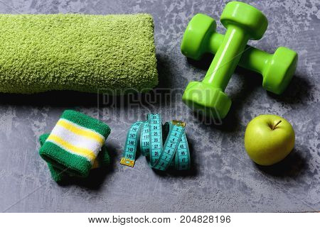 Dumbbells In Green Color, Apple, Towel, Hand Band And Tape
