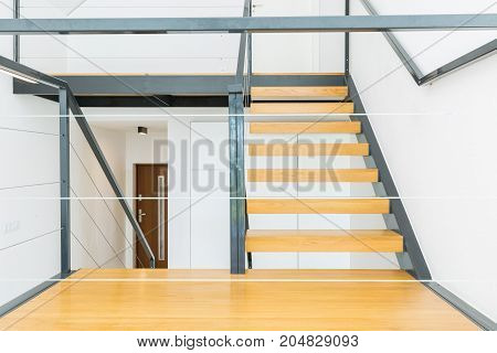 Wooden Stairs And Metal Railing