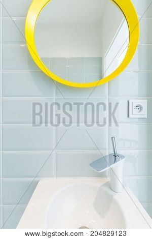 Simple Bathroom With Yellow Mirror