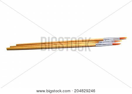 Three Paintbrush With Wooden Handle On White Background Isolated