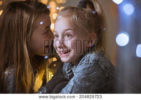 Girl Telling Secret To Sister