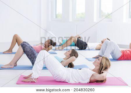 Practicioners Exercise In Fitness Studio