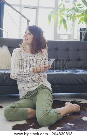 Cheerful Woman Speaking On Mobile Phone, Sitting On Living Room
