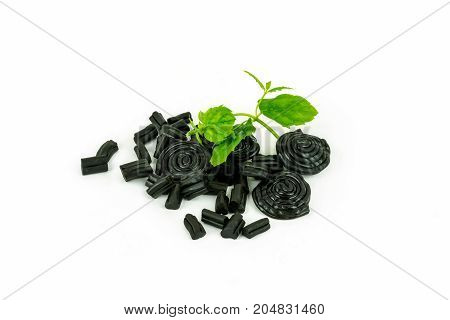 Studio shot of delicious pile of licorice candy and mint.