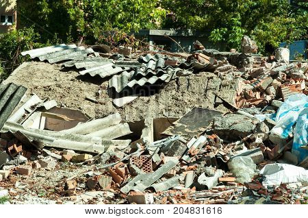 Remains of demolished house collected on the pile destroyed by grenade in the city during the war
