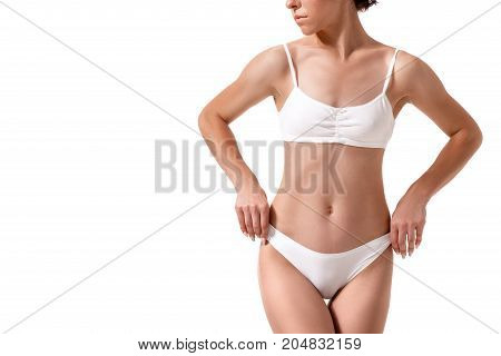 Slim tanned woman's body. Isolated over white background. Diet. Sport. Health plastic surgery