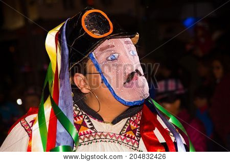 Quito, Ecuador - february 02, 2016: An unidentified man dressed up a mask during the Diablada.