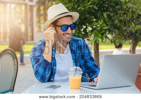 Closeup Portrait Of Young Handsome Caucasian Man In Street Cafe In Process Of Joyful Online Communic