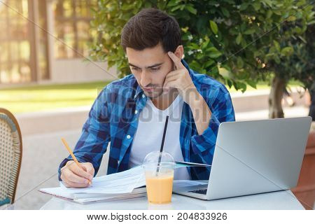 Closeup Image Of Young Handsome Caucasian Male Checking Important Papers For Work Trying Not To Miss