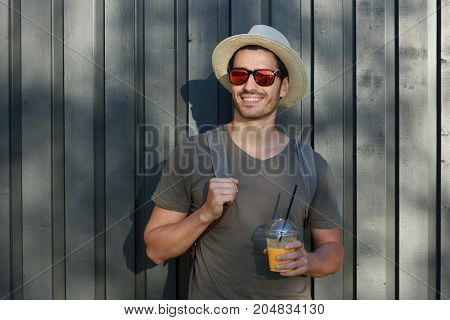 Horizontal Image Of Handsome Caucasian Guy Pictured On Grey Wooden Background In Rural Environment W
