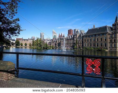 Binnenhof (Dutch Parliament) on modern city background The Hague (Den Haag) Netherlands
