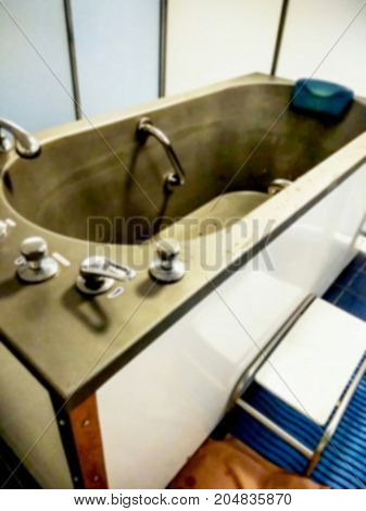 Blured view of metal bath for water spa treatments