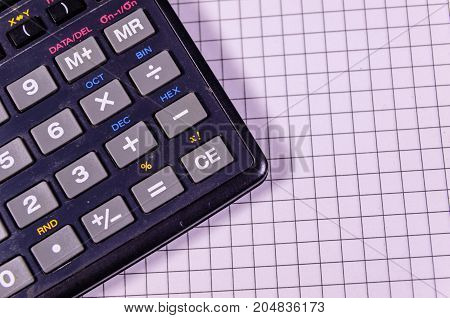 Calculator On Blank Sheet Of Paper. Top View