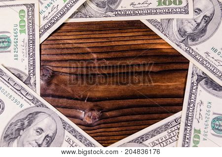 Frame Of One Hundred Dollars Bills On Wooden Table. Top View