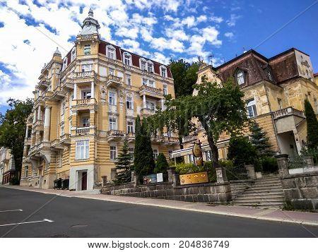 Marianske Lazne (Marienbad) Czech Republic - July 30 2017: Beautiful buildings on Russian street on blue summer sky background