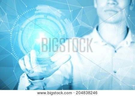 young businessman touching a hologram of the virtual interface