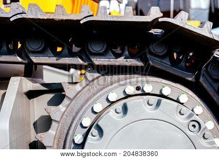 Big bulldozer details closeup on a construction site