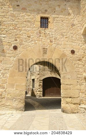 Stone arch in the medieval village of Pals located in the middle of the Emporda region of Girona Catalonia Spain.