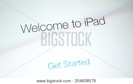 PARIS FRANCE - SEP 12 2014: Welcome to iPad signage on the modern retina display of an personal tablet computer made by Apple Computers during first start or update upgrade