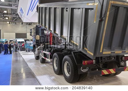 MOSCOW, SEP, 5, 2017: Close up view on Chinese FAW dump truck exhibit on Commercial Transport Exhibition ComTrans-2017. FAW commercial transport on exhibition stand Commercial dump trucks Chinese cars